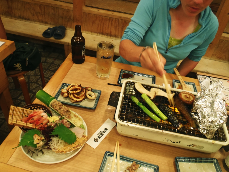 Best meal ever: a plate of sashimi and grill-it-yourself squid, salmon, and veggies.