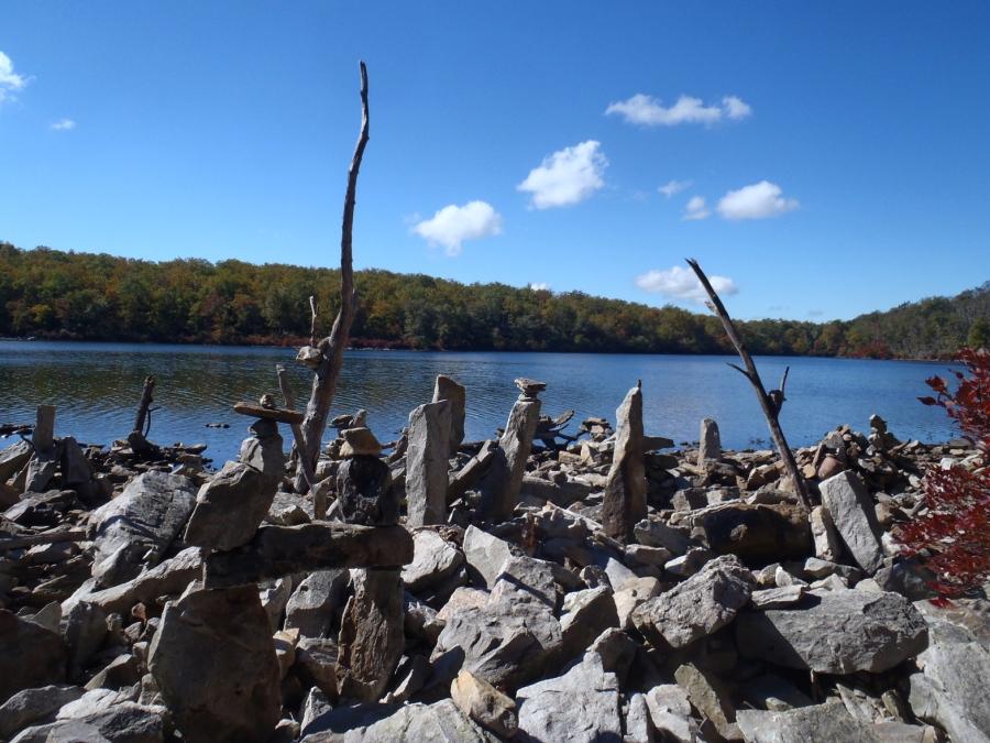 Rock sculptures along shore.
