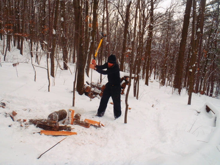 Splitting wood.