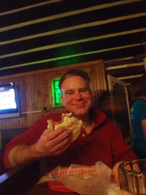 John's enjoying that burger.