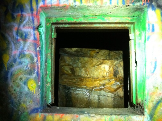 Bedrock through a window in the tunnel.