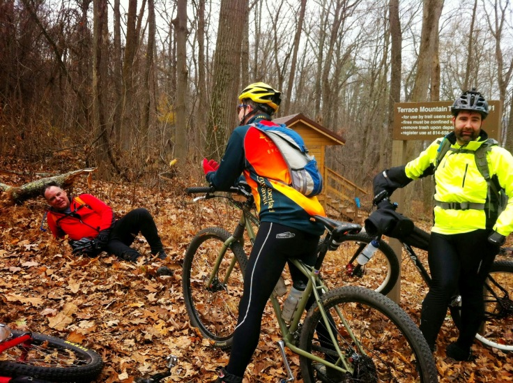 Taking a break at the bottom of Fink Road. The structure in the background is an Adirondack shelter on the TMT.