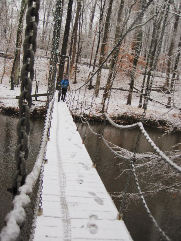 Over the swinging bridge.