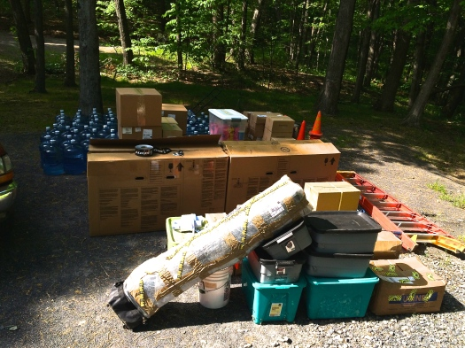 The first pile of stuff is dropped off where the registration tent/HQ will be.