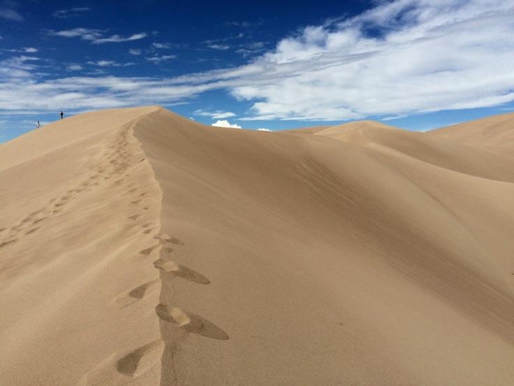 dunes against clouds